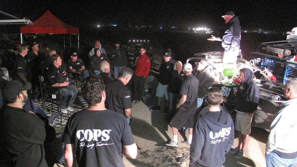 Friday night crew meeting at the COPS' main pit.