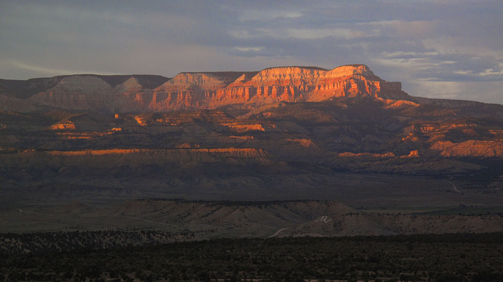 A sunset at Bryce. In the foreground is Tropic, UT, home of über pedestrian pizza.