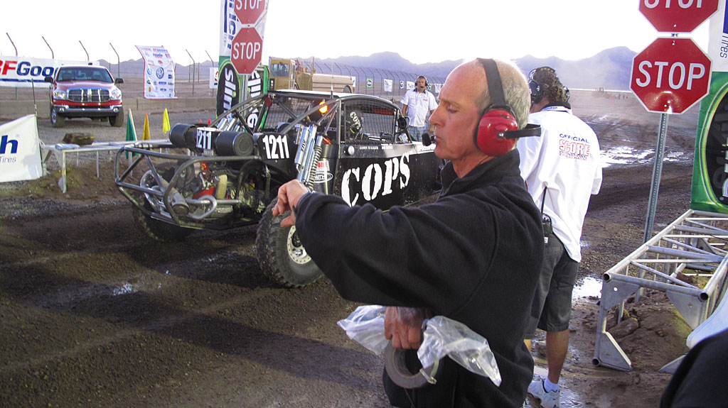 Joe Taylor, COPS Crew Chief, sees the Class 12 car off the starting line.