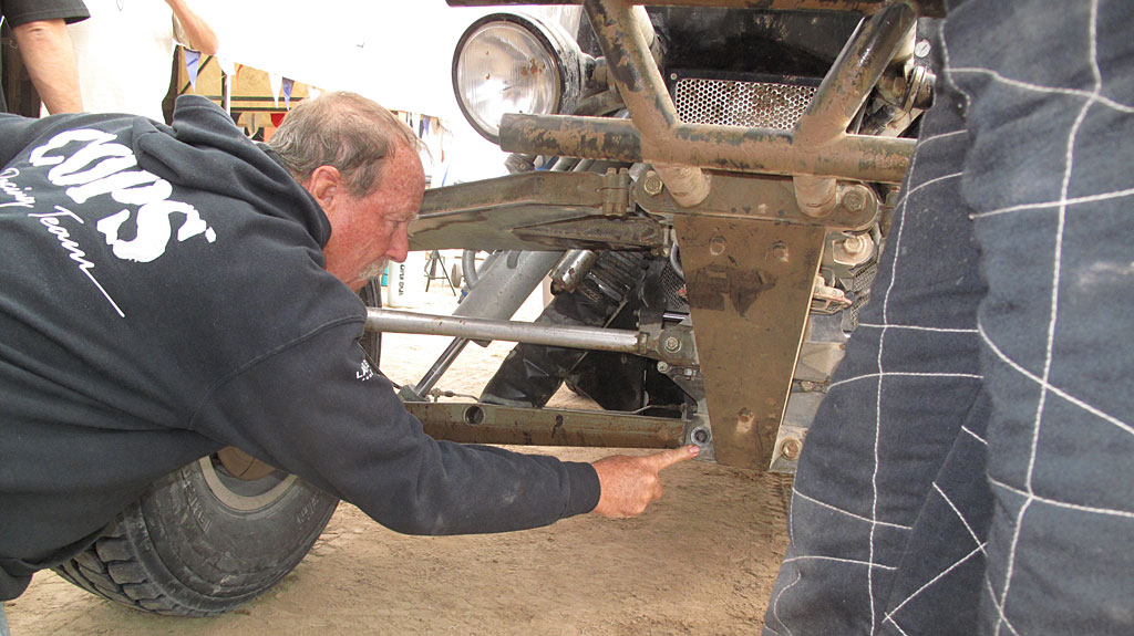 At the BFG pits at Cuidad Insurgentes, Ron Martin discovers a sheared bolt on the Class 1's front suspension.