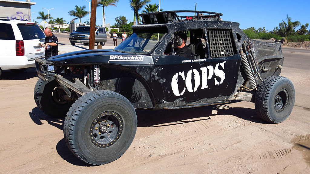 The COPS prerunner was built by Racer Engineering, sporting a race Corvette motor and three feet of suspension travel. It has two front seats and one back seat - perfect for optimum course reconnaissance.