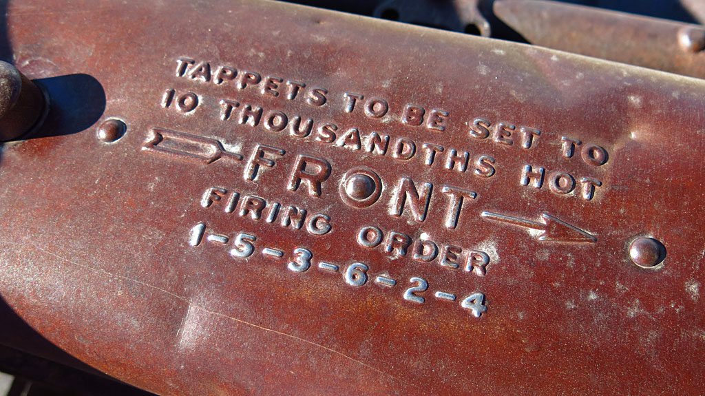 Maintenance instructions on an old Ford's valve cover.