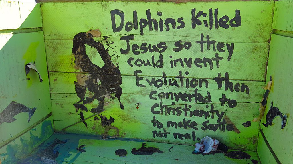 "Philosophy at East Jesus: ""Dolphins killed Jesus so they could invent Evolution then converted to Christianity to make Santa not real."""