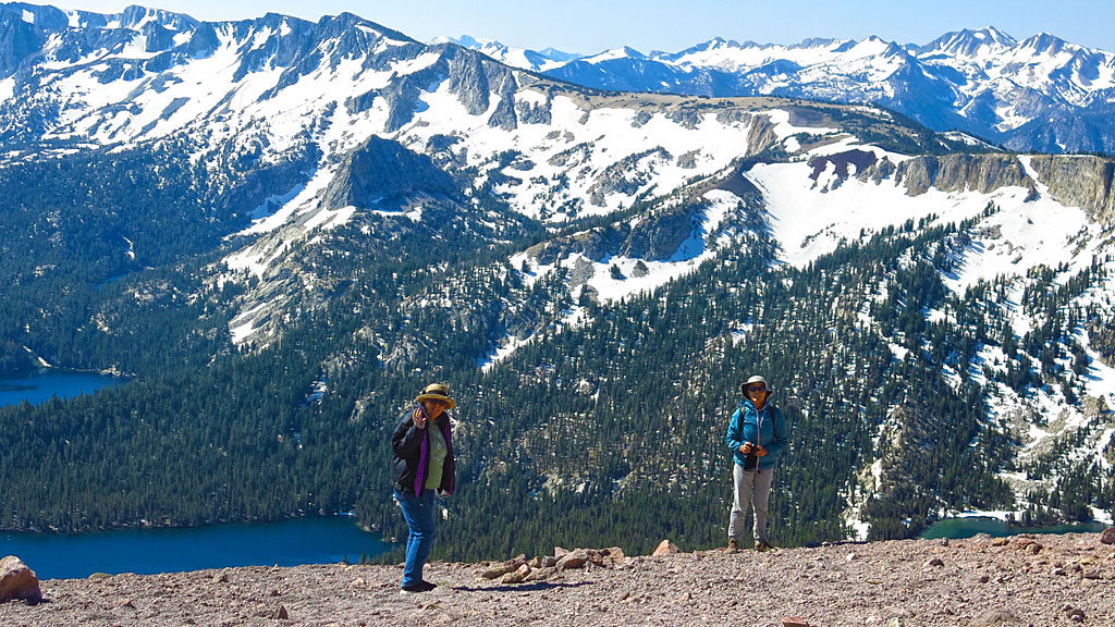 Jan and Carol look at distant lakes from the top of Mammoth Mountain.