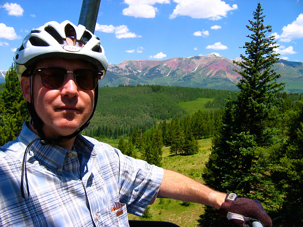 Eric proves you can go mountain biking and have a great deal of whimsy while wearing an ironed, collared shirt.