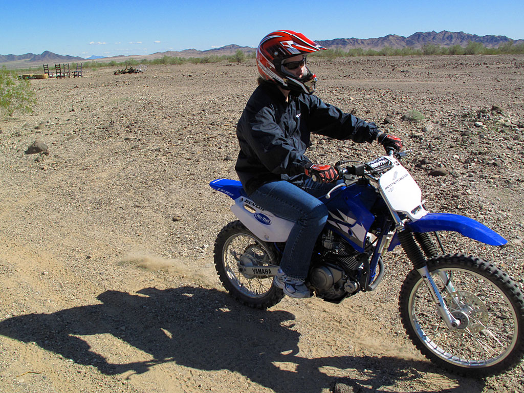 KT tears up the desert on her TTR.
