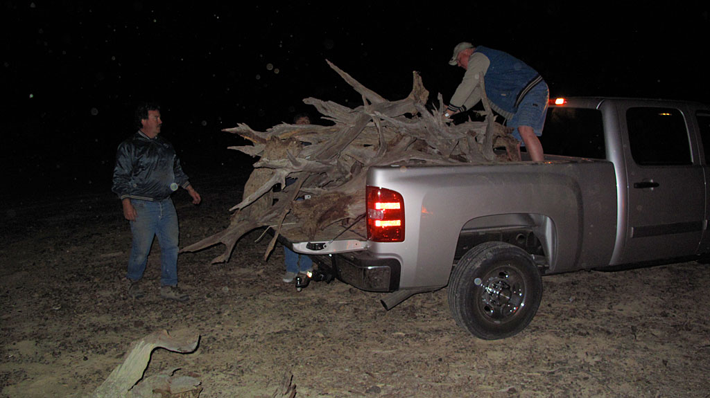 ... while Henri and Robert deliver a little more ironwood and mesquite firewood.