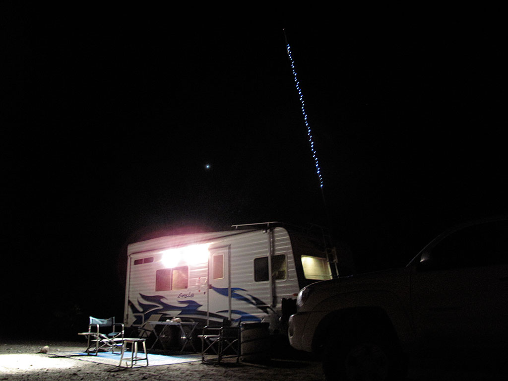 Sting lights on the flagpole aid over-served campers find their way back to camp in the darkness.