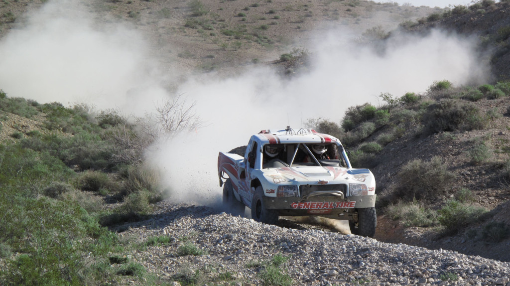 A Trophy Truck running up front on the first lap.