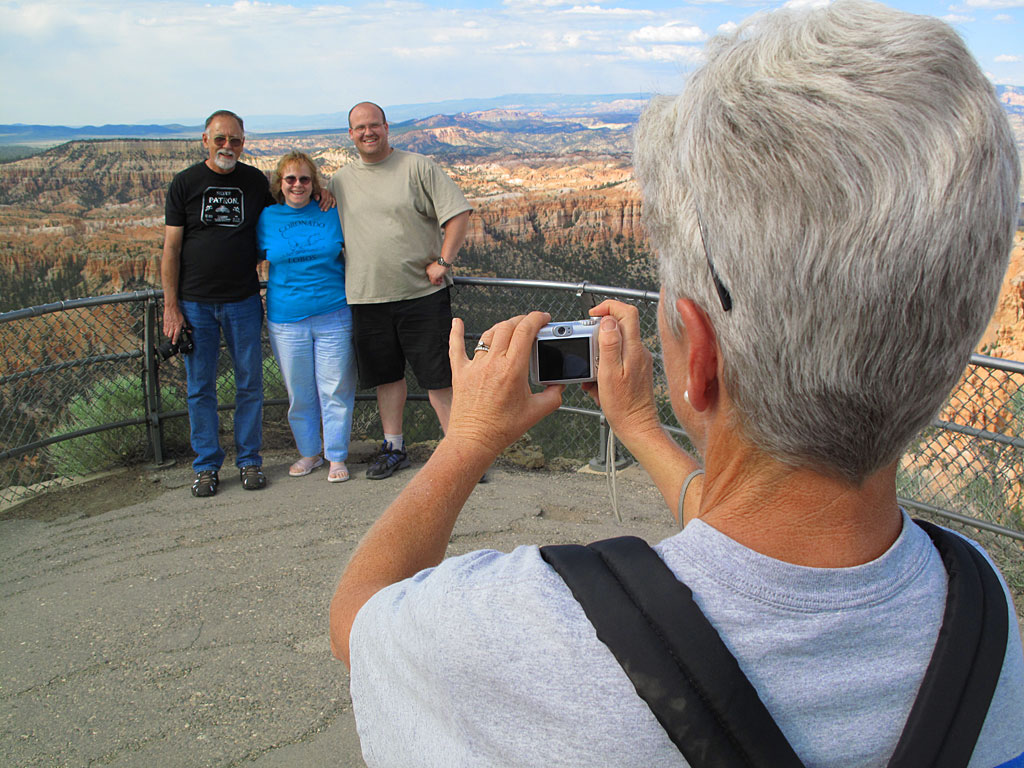 Carol snaps a photo for some tourists.