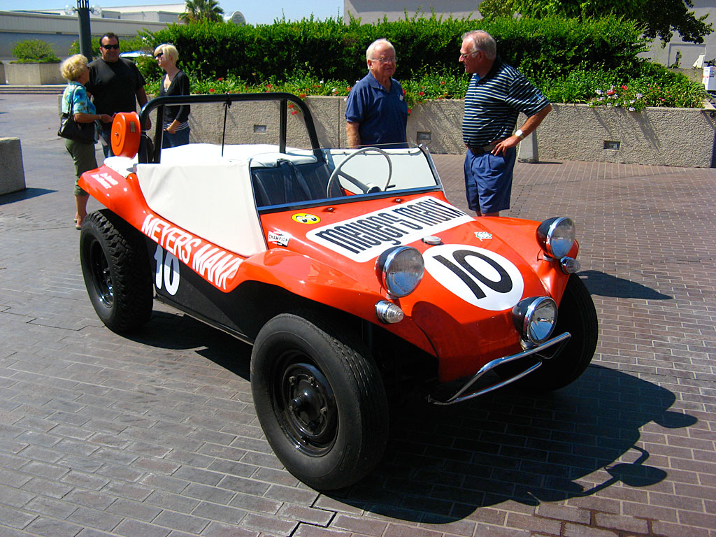 Bruce Meyers stands next to the revolutionary Meyers Manx. It was produced by his Fountain Valley, California company from 1964 to 1971, in the form of car kits applied to shortened chassis of Volkswagen Beetles.