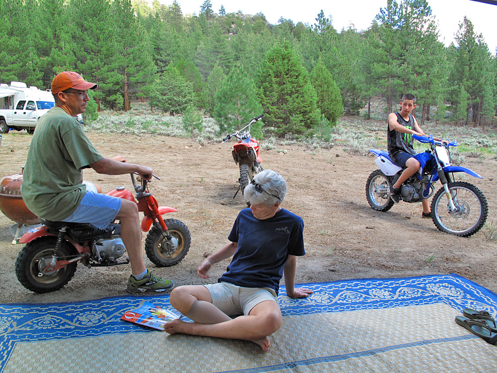 Tito, Carol and Matthew, each in their own way, relaxing at camp.