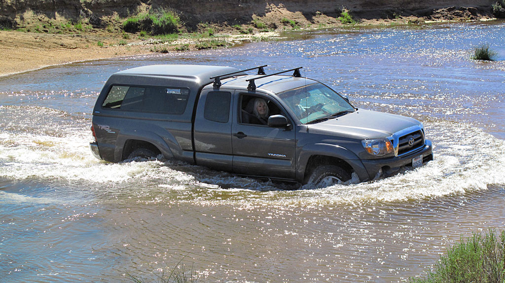 Dave and Irene drive their new Tacoma across the South Fork of the Kern River in Monache Meadows.