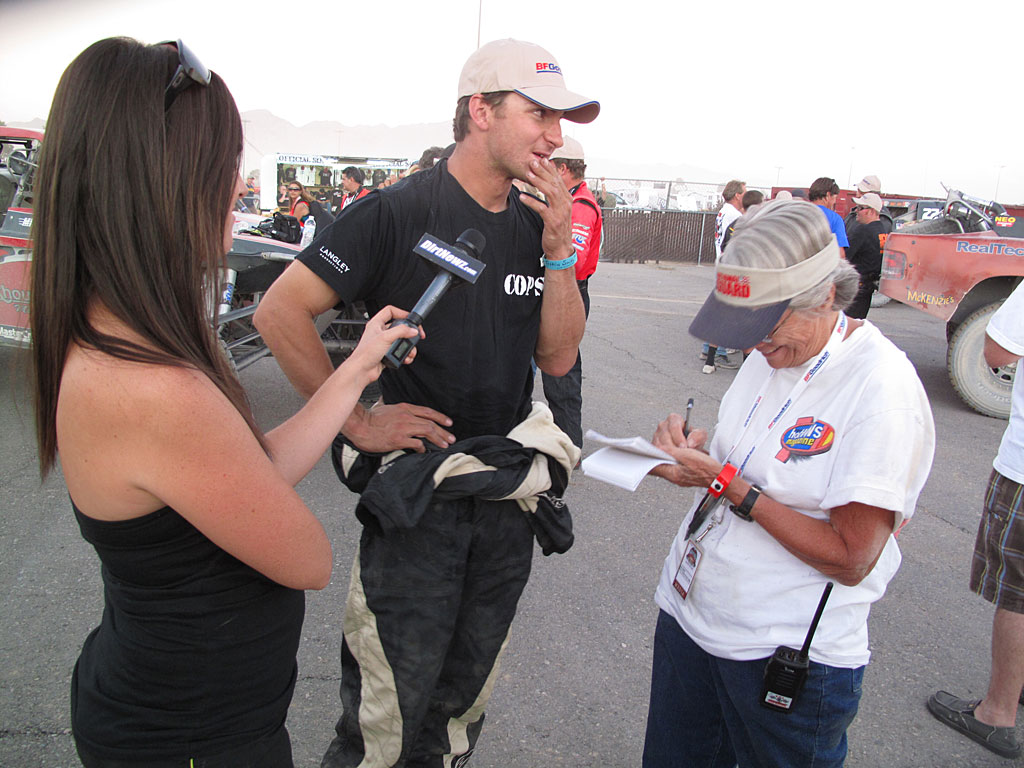 Smith is interviewed at the finish by the media after a well-run race.