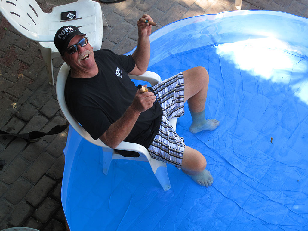 Ron manages to stay cool in a kiddie pool the team purchased - the hotel where we were staying didn't have its own pool. A beer helps too.