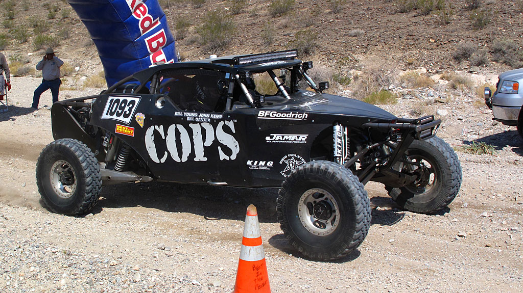John Langley started the COPS Class 10 in the V2R race. Fifty miles later, he would collide with an overturned race car hidden in dust, taking the COPS car out of the race.