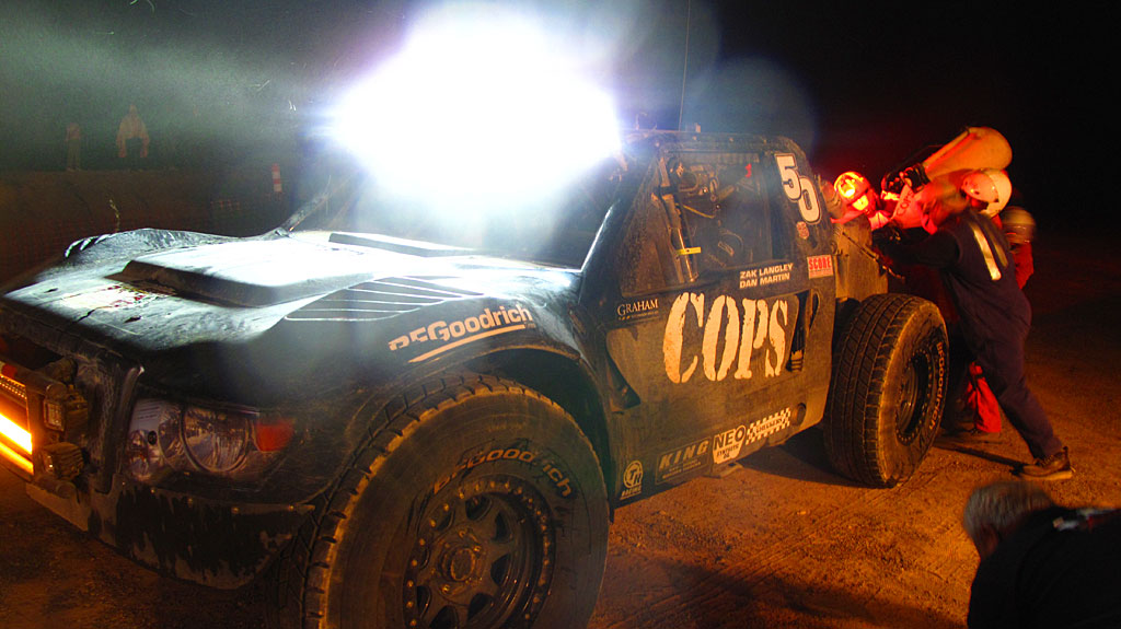 Dan Martin arrives in the COPS Trophy Truck and takes on fuel for his trip over the mountains to the next pits near Loreto.