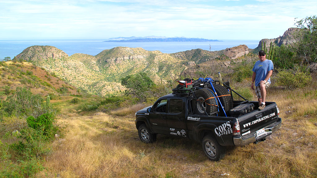 Steve and I take a break along Highway 1 - Monserrate and Santa Catalina islands are in the background.