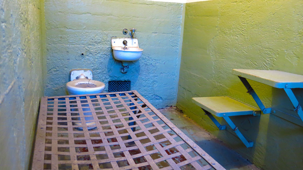 Living conditions were not plush at the prison. Cells came with a bed, sink, toilet, seat and table. Ceilings were 7' tall.