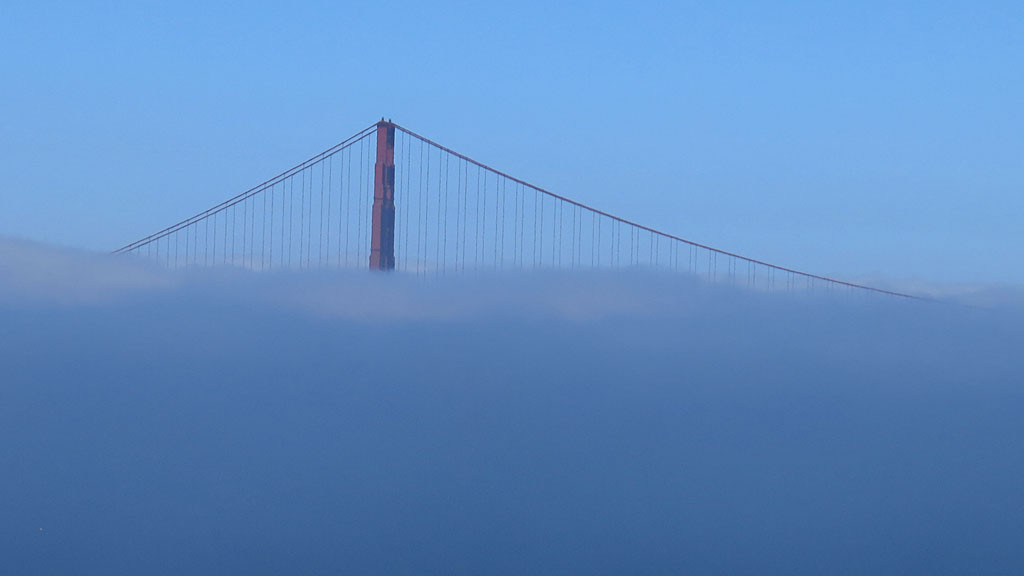 The Golden Gate Bridge in fog.