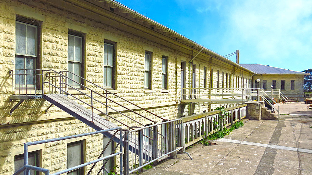 Building 64 were residential apartments, first used by the military, then by the prison.