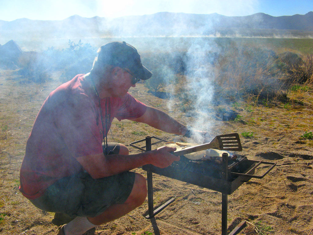 As all good spectators, we ate. Steve handled the chicken-and-tortilla-grilling duties.