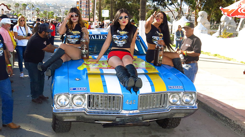 John Swift is driving the 1972 Olds Cutlass in the Pioneer Era class, for 1967 through 1975 cars. The car was festooned with a tequila version of the Tecate Girls.