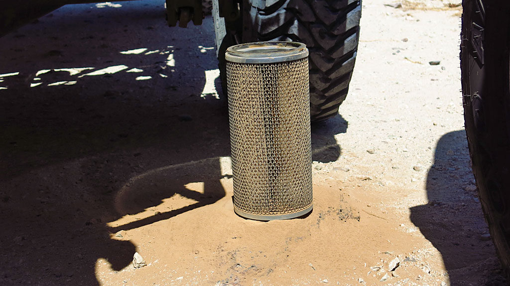 Dennis swapped out the #250's air filter - he dropped the old filter on the ground and a little light brown silt came out.