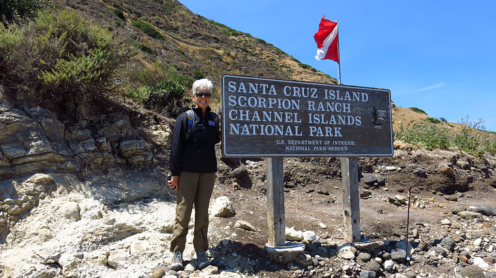 Carol poses for the obligatory photo-by-National-Park-sign photo.