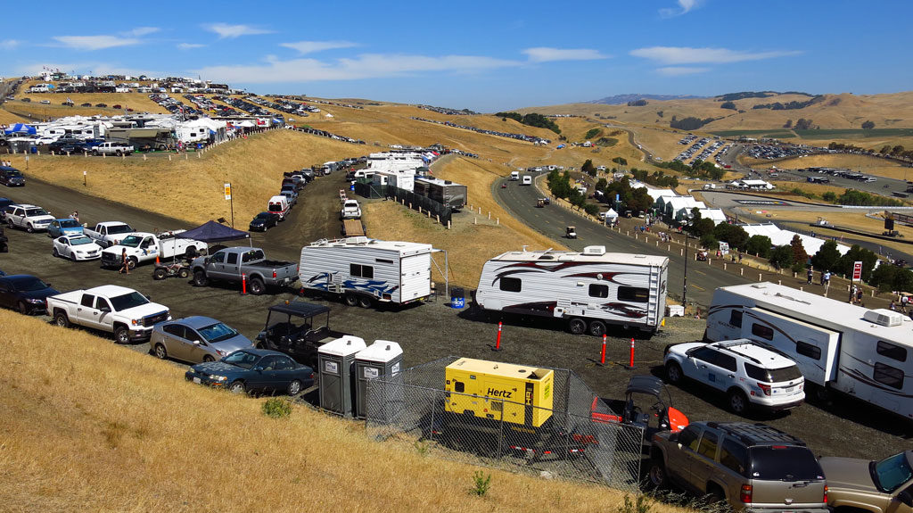 Sunday morning at 6 crowds start to arrive; before the main event at noon, hilltops will be covered with parked cars and RVs.
