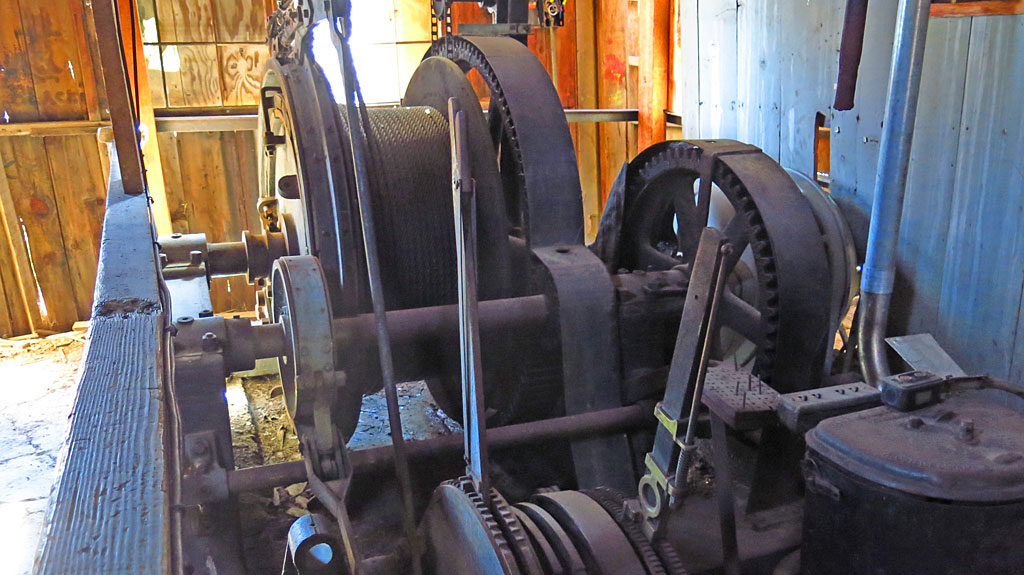 Inside the hoist building is a large single-drum hoist -- the motor, the electrical equipment and controls, even the operator's chair, are all still there.