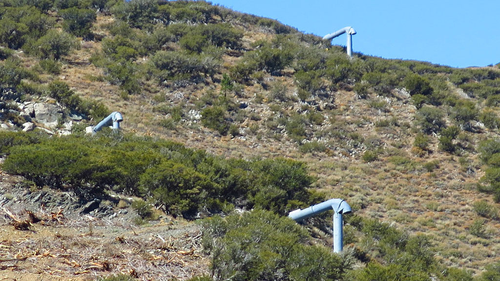 """Caltrans: """"... permanent propane and oxygen gas explosion chambers (<a href=""""http://www.mountec-corp.com/en/avalanche/gazex"""" target=""""_blank"""">GazEx</a>) at the head of avalanche chutes, approximately 3/4 mile upslope from U.S. Highway 395. The GazEx system consists of exploders mounted in the avalanche starting zones above the highway. The exploders are large tubes, closed at one end, open at the other, with their open ends located above and directed onto the snow. The exploders are filled by remote control with propane and oxygen, then remotely detonated. The shelters contain the remote control system and the oxygen and propane tanks for the system. The operator controls the system from a safe location using a computer linked by radio to the control systems in the shelters. The propane and oxygen tanks would be removed in the spring and replaced in late fall/early winter (October 15-November 1). This would avoid having propane and oxygen gas tanks on the mountain during fire season."""""""