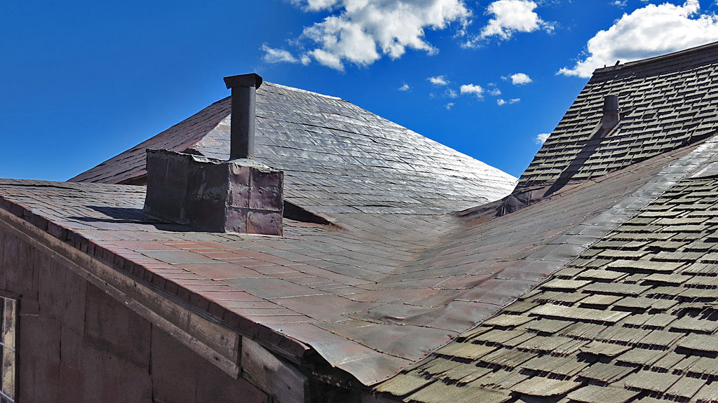 Empty tin cans converted into roofing material -- most likely, a hot tin roof.