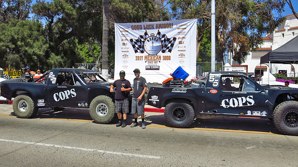 For the 2017 Mexican 1000, COPS Racing campaigned two trucks: Zak Langley and Josh Valko will pilot the #55 Trophy Truck, while somewhere back in the dust, John Langley and Mike Howell will be in the Trophy Spec #250. That's COPS Crew Chief Mike Meehan with Josh escorting the trucks through Contingency and Tech.
