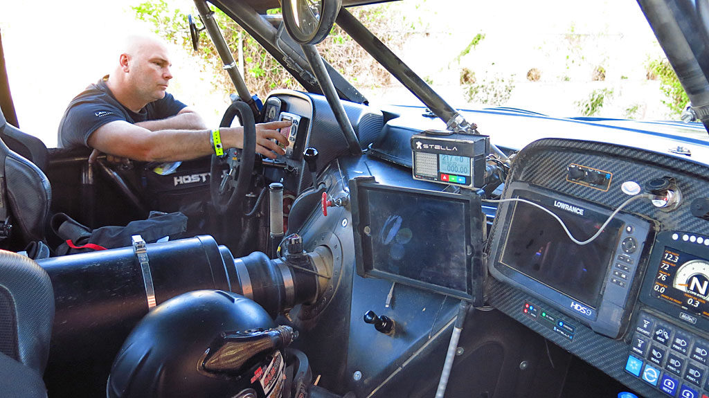 Inside the #250's cockpit, Co-driver Mike makes last-minute adjustments to John's GPS.