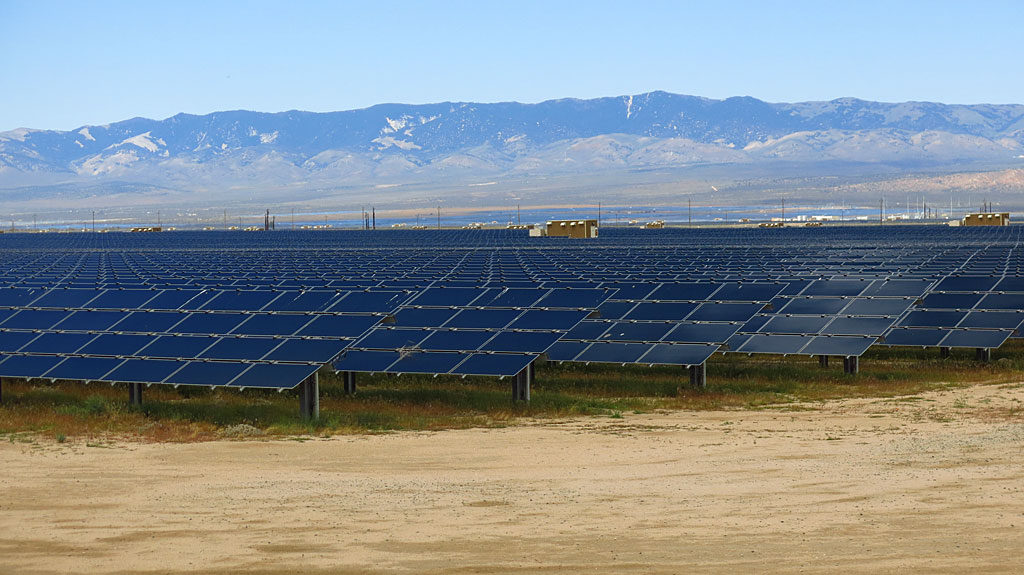 Many, many-acre solar voltaic panels line both sides of CA-138.