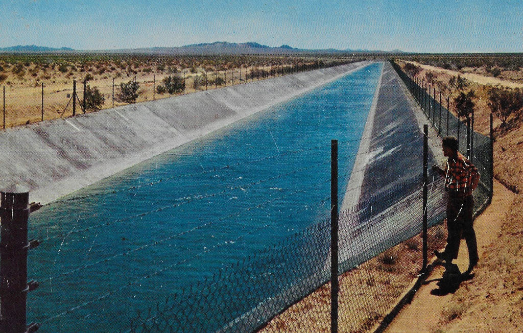 On back: This great Colorado River aqueduct carries the precious water that is the very life's blood of Southern California. This marvel of engineering crosses hundreds of miles of arid deserts and mountains before reaching Southern California. It passes across the desert a few miles north of Palm Springs.